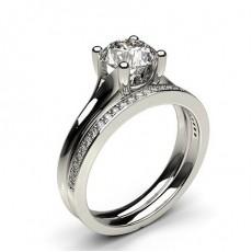 Diamant Verlobungsring in einer Krappenfassung mit passenden Ring