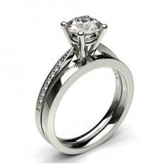 Diamant Verlobungsring in einer Eingeriebenefassung mit passenden Ring