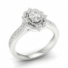 Bague halo de diamants ovales sertis micro pavé