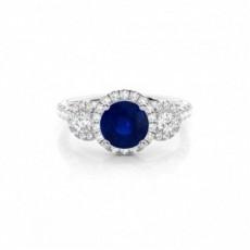 Zinkeneinstellung runder blauer Saphir-Drei-Stein-Ring